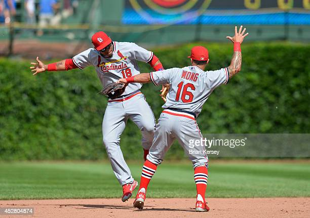 Oscar Taveras and Kolten Wong of the St Louis Cardinals celebrate their win over the Chicago Cubs at Wrigley Field on July 27 2014 in Chicago...