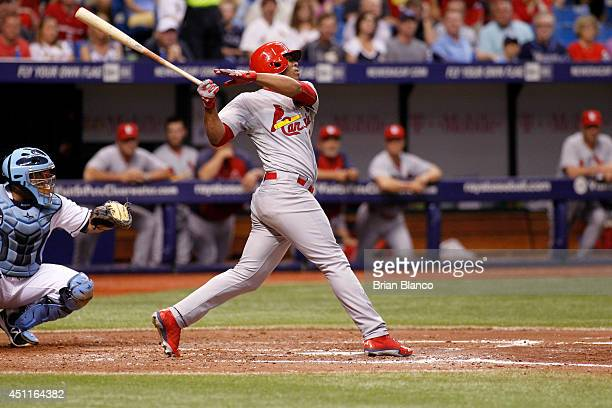 Oscar Taveras of the St Louis Cardinals bats during a game against the Tampa Bay Rays on June 10 2014 at Tropicana Field in St Petersburg Florida