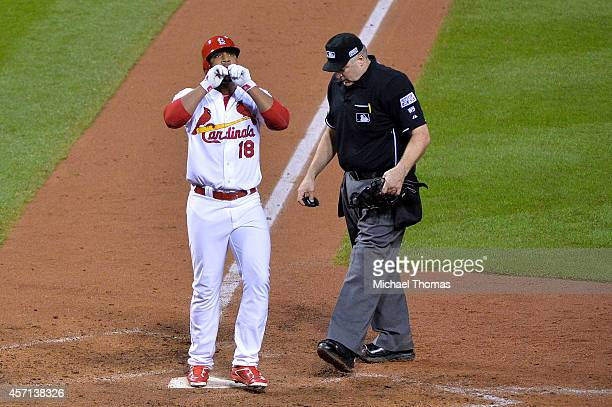 Oscar Taveras of the St Louis Cardinals celebrates hitting a solo home run in the seventh inning against the San Francisco Giants during Game Two of...