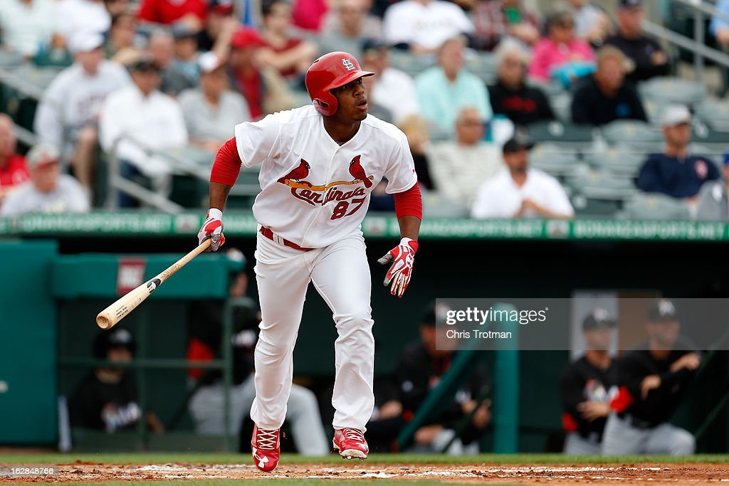 Oscar Taveras #87 of the St. Louis Cardinals hits a grand slam home run in the first inning against the Miami Marlins at the Roger Dean Stadium on February 28, 2013 in Jupiter, Florida.