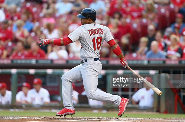 Oscar Taveras of the St Louis Cardinals hits an RBI single in the first inning during the game against the Cincinnati Reds at Great American Ball...