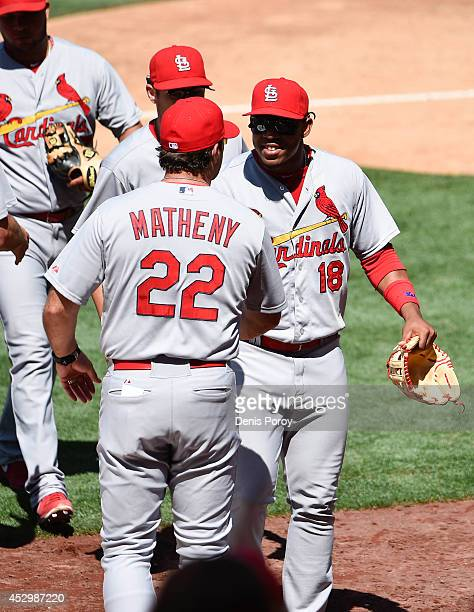 Oscar Taveras of the St Louis Cardinals right is congratulated by manager Mike Matheny after beating the San Diego Padres 62 in a baseball game at...