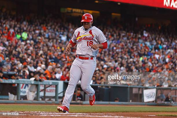 Oscar Taveras of the St Louis Cardinals scores a run against the San Francisco Giants during the third inning at ATT Park on July 2 2014 in San...