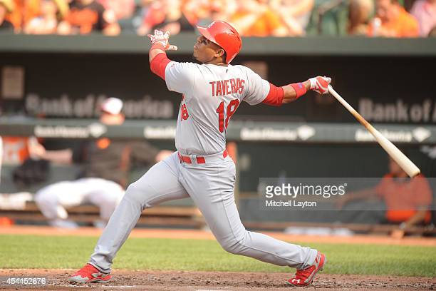 Oscar Taveras of the St Louis Cardinals takes a swing during a baseball game against the Baltimore Orioles on August 9 2014 at Oriole Park at Camden...