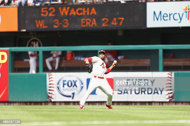 Oscar Taveras of the St Louis Cardinals throws against the San Francisco Giants at Busch Stadium on May 31 2014 in St Louis Missouri