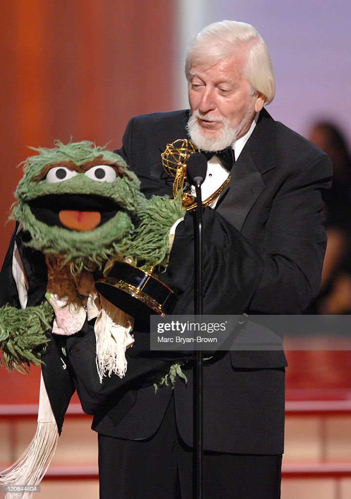 """Oscar the Grouch and <a gi-track='captionPersonalityLinkClicked' href=/galleries/search?phrase=Caroll+Spinney&family=editorial&specificpeople=653956 ng-click='$event.stopPropagation()'>Caroll Spinney</a> accept Outstanding Children's Series Performer award for """"Sesame Street"""""""