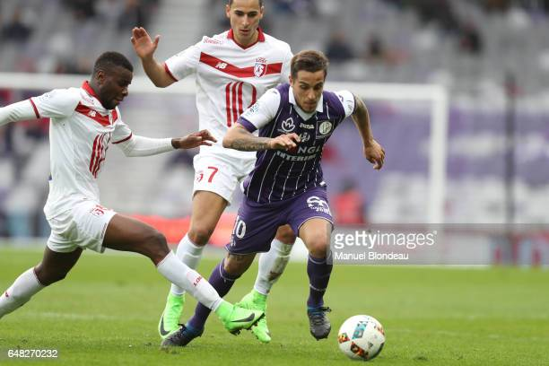 Oscar Trejo of Toulouse and Bakary Soumaoro of Lille during the French Ligue 1 match between Toulouse and Lille at Stadium Municipal on March 5 2017...
