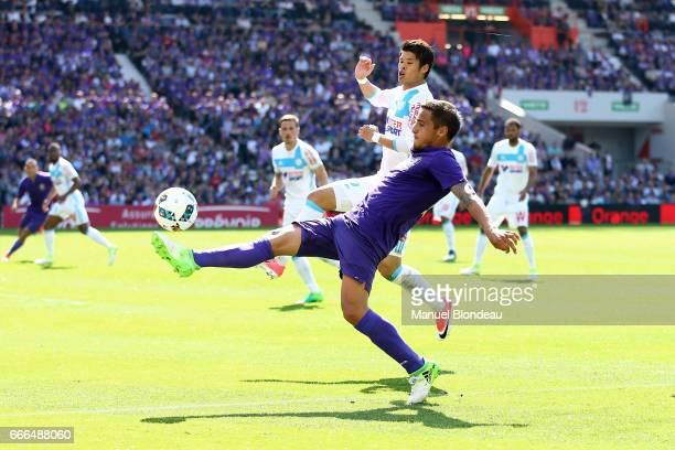 Oscar Trejo of Toulouse and Hiroki Sakai of Marseille during the Ligue 1 match between Toulouse FC and Olympique de Marseille at Stadium Municipal on...