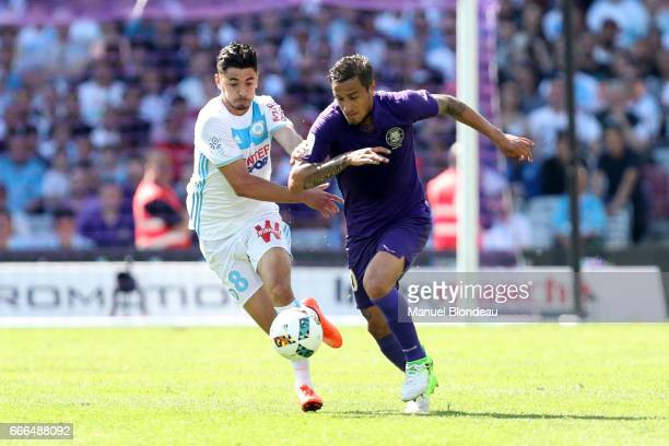Oscar Trejo of Toulouse and Morgan Sanson of Marseille during the Ligue 1 match between Toulouse FC and Olympique de Marseille at Stadium Municipal...