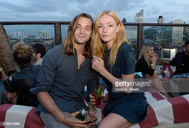 Oscar Tuttiett and Clara Paget attend the Warner Summer Party in association with British GQ at Shoreditch House on July 8 2015 in London England