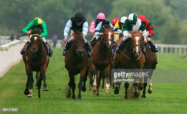 Oscar Urbina and Banjo Patterson come up the straight to land The Main Line Electrical Maiden Stakes Race run at Windsor Racecourse on June 25 2005...