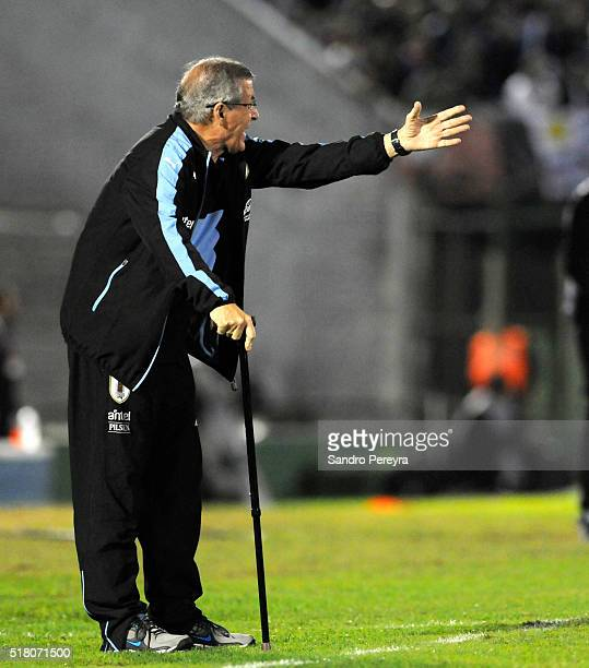 Oscar Washington Tabarez coach of Uruguay gives instructions to his players during a match between Uruguay and Peru as part of FIFA 2018 World Cup...