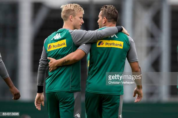 Oscar Wendt and Raul Bobadilla during the training session of Borussia Moenchengladbach at BorussiaPark on August 18 2017 in Moenchengladbach Germany