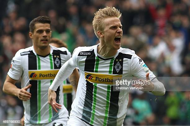 Oscar Wendt of Borussia Moenchengladbach celebrate after their first goal during the Bundesliga match between Borussia Moenchengladbach and Borussia...