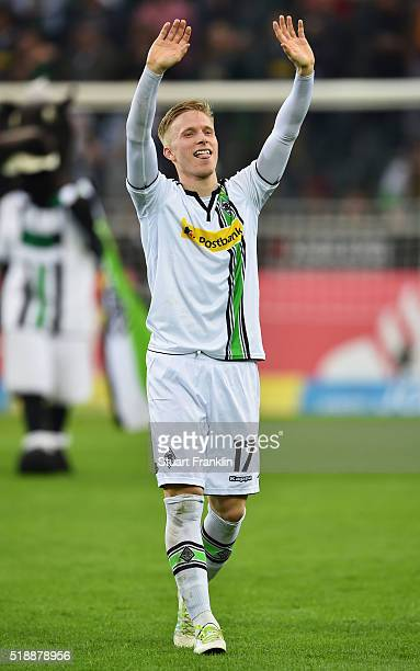 Oscar Wendt of Borussia Moenchengladbach celebrates victory after the Bundesliga match between Borussia Moenchengladbach and Hertha BSC at...