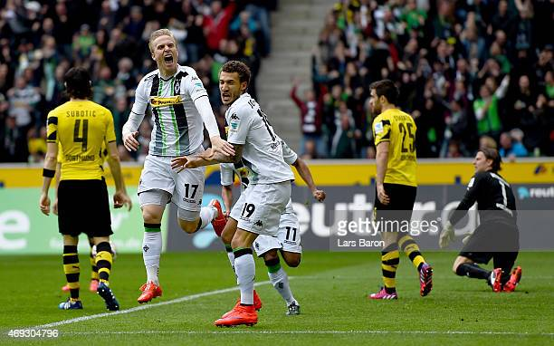 Oscar Wendt of Borussia Moenchengladbach celebrates with team mates after scoring his teams first goal during the Bundesliga match again Borussia...