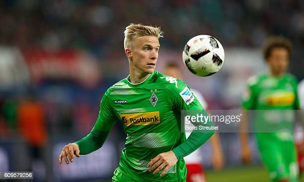Oscar Wendt of Borussia Moenchengladbach controlls the ball during the Bundesliga match between RB Leipzig and Borussia Moenchengladbach at Red Bull...