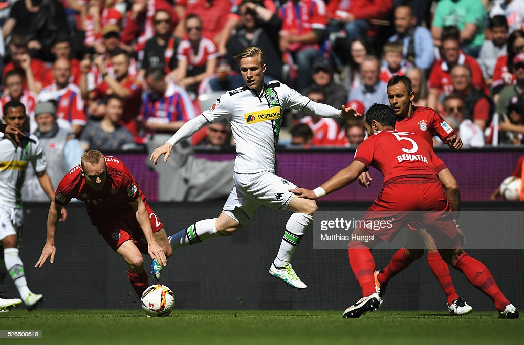 Oscar Wendt of Borussia Moenchengladbach controls the ball under pressure of Bayern defense during the Bundesliga match between Bayern Muenchen and Borussia Moenchengladbach at Allianz Arena on April 30, 2016 in Munich, Germany.