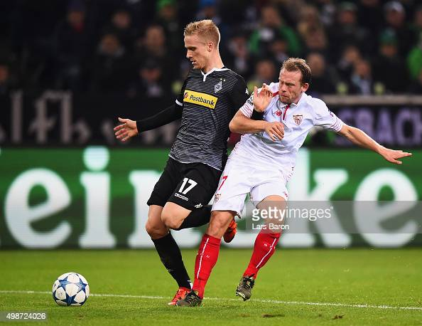 Oscar Wendt of Borussia Moenchengladbach holds off Michael KrohnDehli of Sevilla during the UEFA Champions League Group D match between Borussia...
