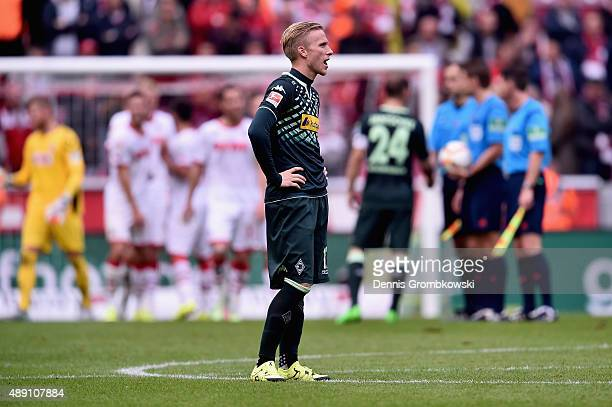Oscar Wendt of Borussia Moenchengladbach looks dejected after the Bundesliga match between 1 FC Koeln and Borussia Moenchengladbach at...