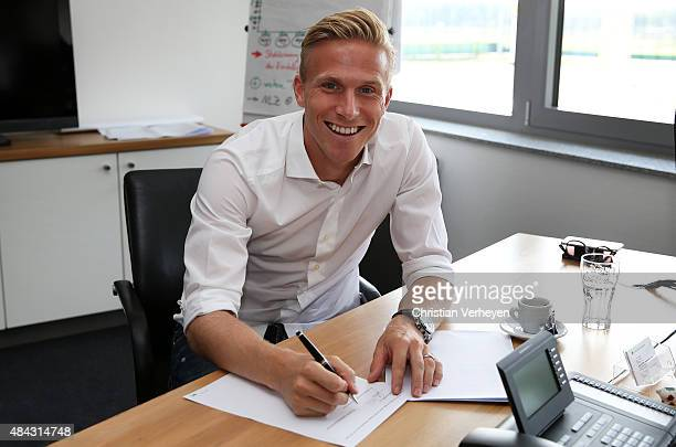 Oscar Wendt of Borussia Moenchengladbach signs a new contract for Borussia Moenchengladbach at BorussiaPark on Ausgust 17 2015 in Moenchengladbach...