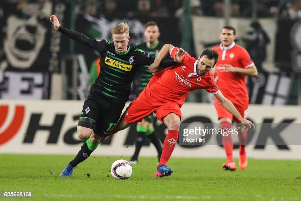 Oscar Wendt of Moenchengladbach and Borja Valero of Fiorentina battle for the ball during the UEFA Europa League Round of 32 first leg match between...