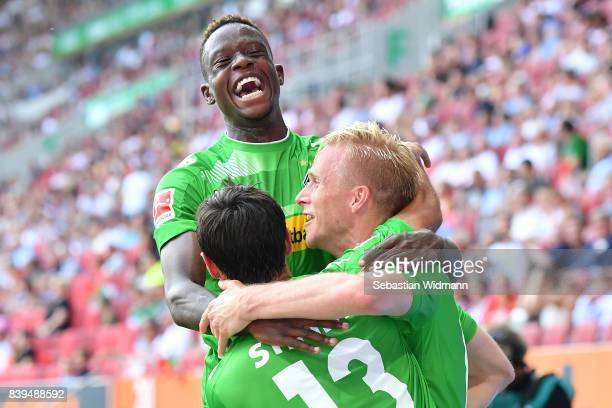 Oscar Wendt of Moenchengladbach celebrates his goal with Lars Stindl of Moenchengladbach and Denis Zakaria of Moenchengladbach during the Bundesliga...