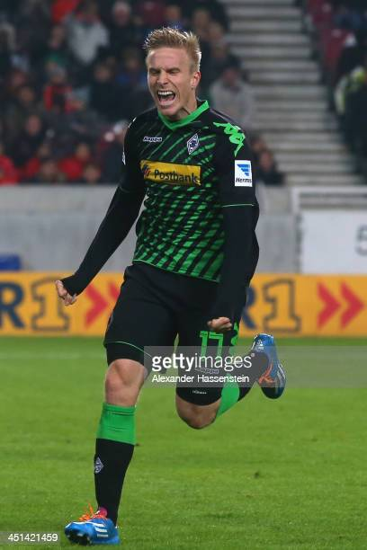 Oscar Wendt of Moenchengladbach celebrates scoring the second team goal during the Bundesliga match between VfB Stuttgart and Borussia...