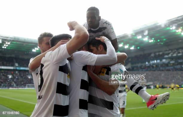 Oscar Wendt of Moenchengladbach celebrates with Jonas Hofmann of Moenchengladbach Lars Stindl of Moenchengladbach and Ibrahima Traore of...