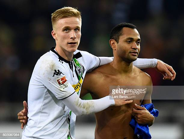 Oscar Wendt of Moenchengladbach celebrates with Raffael of Moenchengladbach after winning the Bundesliga match between Borussia Moenchengladbach and...