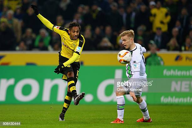 Oscar Wendt of Moenchengladbach defends a shot of PierreEmerick Aubameyang of Dortmund during the Bundesliga match between Borussia Moenchengladbach...