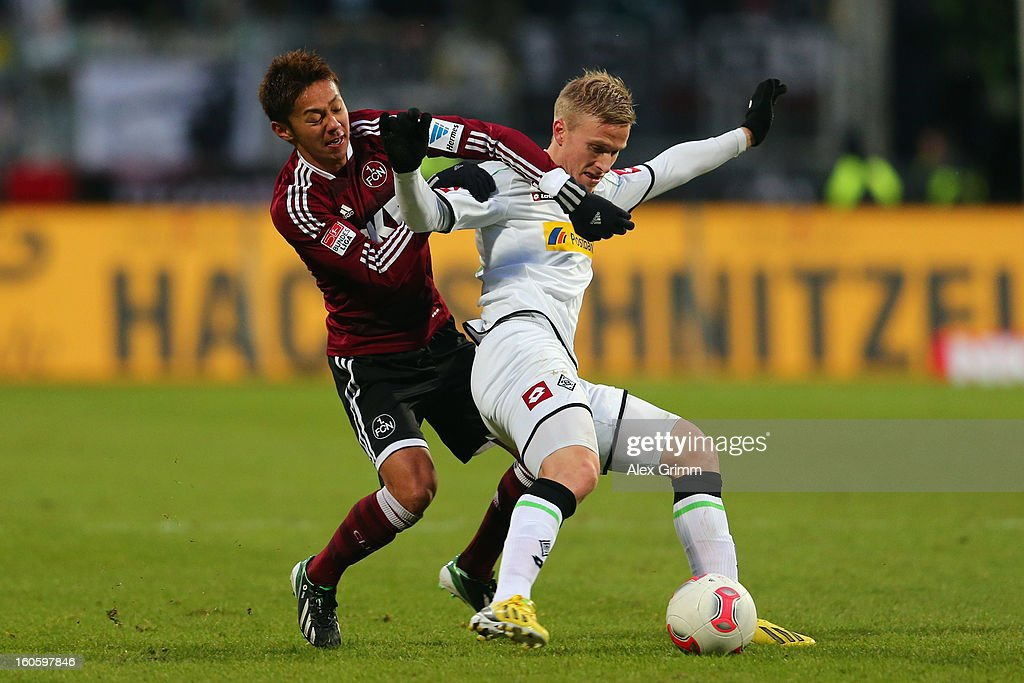 Oscar Wendt (R) of Moenchengladbach is challenged by <a gi-track='captionPersonalityLinkClicked' href=/galleries/search?phrase=Hiroshi+Kiyotake&family=editorial&specificpeople=7645519 ng-click='$event.stopPropagation()'>Hiroshi Kiyotake</a> of Nuernberg during the Bundesliga match between 1. FC Nuernberg and VfL Borussia Moenchengladbach at Easy Credit Stadium on February 3, 2013 in Nuremberg, Germany.