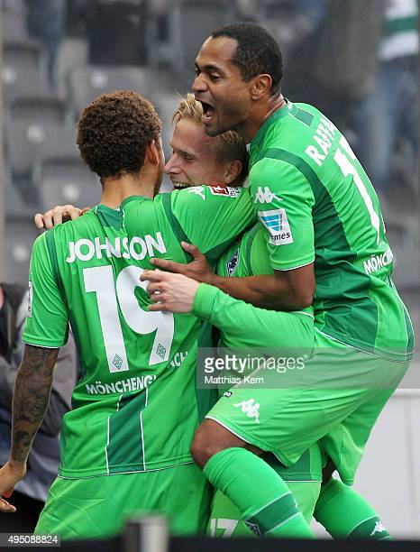 Oscar Wendt of Moenchengladbach jubilates with team mates after scoring the first goal during the Bundesliga match between Hertha BSC and Borussia...