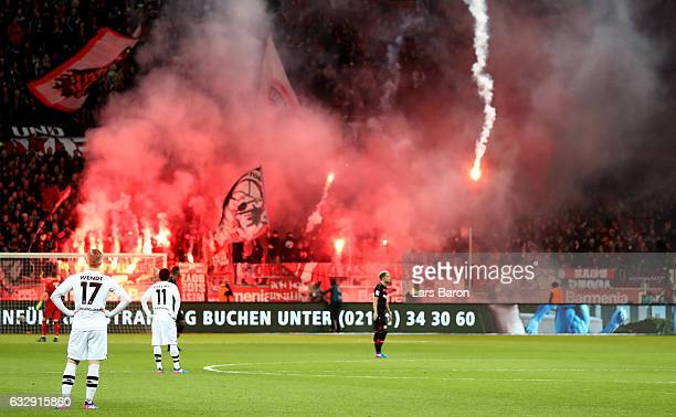 Oscar Wendt of Moenchengladbach looks to the flares burned by fans of Leverkusen during the Bundesliga match between Bayer 04 Leverkusen and Borussia...