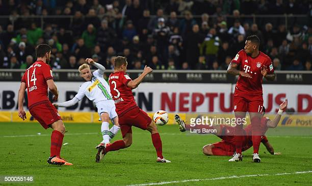 Oscar Wendt of Moenchengladbach scores his teams first goal during the Bundesliga match between Borussia Moenchengladbach and FC Bayern Muenchen at...