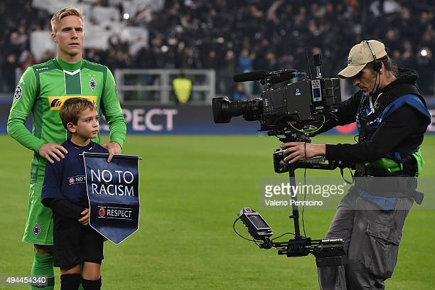 Oscar Wendt of VfL Borussia Moenchengladbach carries the No to Racism pennant during the UEFA Champions League group stage match between Juventus and...