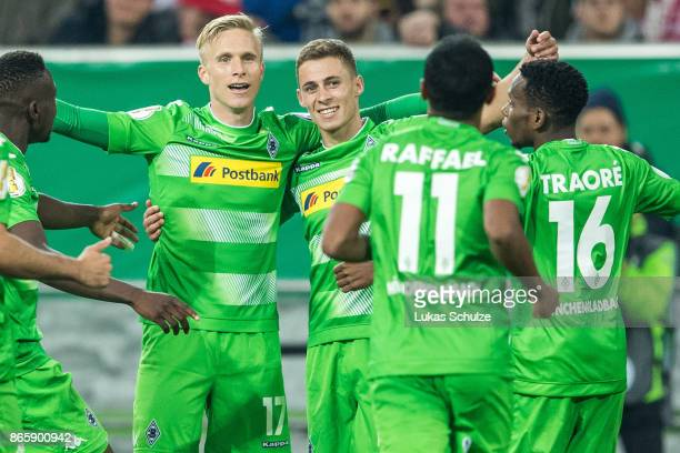 Oscar Wendt scorer Thorgan Hazard and team mates of Moenchengladbach celebrate their teams first goal during the DFB Cup match between Fortuna...