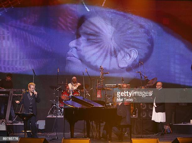 Oscar winner music composer A R Rahman performs along with singers Hariharan Sivamani at a concert 'A R Rahman Unplugged' organised to mark the 50th...