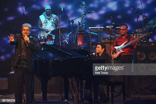 Oscar winner music composer A R Rahman performs along with singers Hariharan and Sivamani at a concert 'A R Rahman Unplugged' organised to mark the...