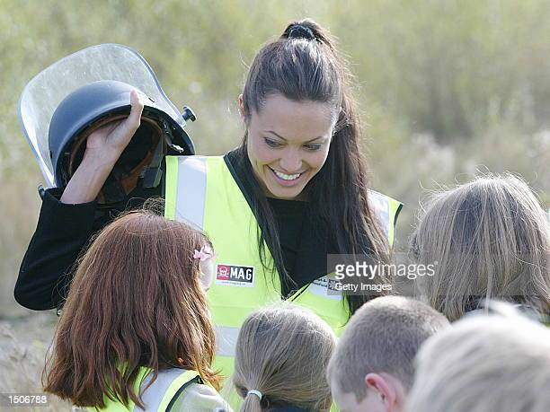 Oscar winning actress Angelina Jolie plays with a student's helmet October 19 2002 in Cheshire United Kingdom The film star who supports the charity...