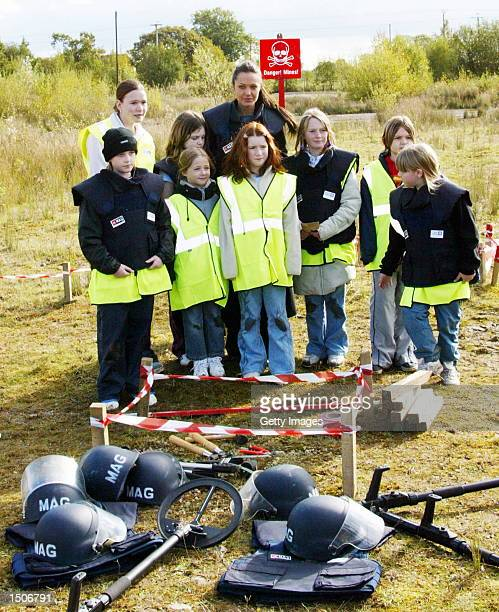 Oscar winning actress Angelina Jolie poses with pupils from Lostock Gralam primary school who were learning about landmine issues and what is...