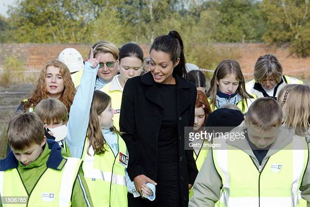 Oscar winning actress Angelina walks with pupils from Lostock Gralam primary school who were learning about landmine issues and what is involved in...
