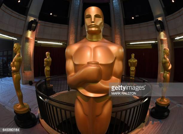 Oscars statues stand at the end of the red carpet arrivals area ahead of the 89th annual Oscars at the Dolby Theater in Hollywood California on...