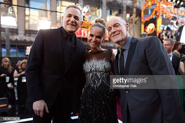 Oscars Telecast Executive Producer Craig Zadan actress Kristin Chenoweth and Oscars Telecast Executive Producer Neil Meron arrive at the Oscars held...
