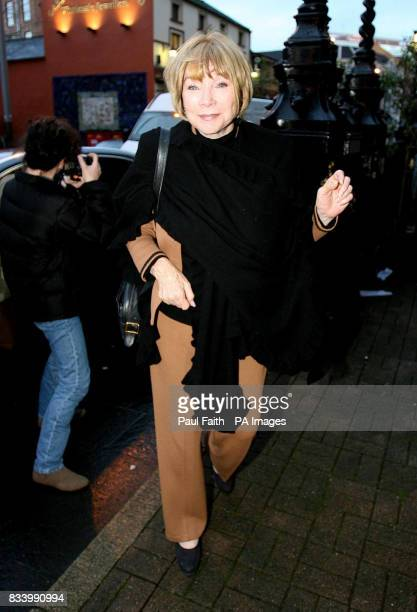 Oscarwinning actress Shirley MacLaine arrives at her hotel in the centre of Belfast with Lord Attenborough ahead of the world premiere of the film...