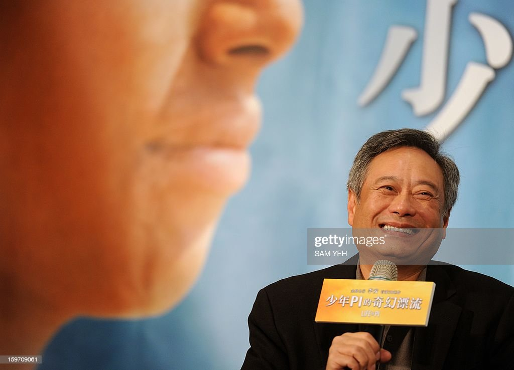 Oscar-winning Taiwan-American director Ang Lee smiles during a press conference in Taipei on January 19, 2013. Lee said he will 'probably' accept an offer to direct the historical epic 'Cleopatra' starring Angelina Jolie, after the Hollywood actress wrote to him asking him to come on board. AFP PHOTO / Sam Yeh
