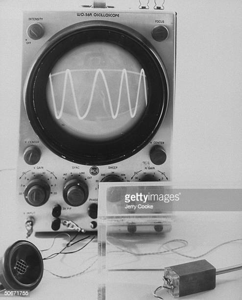 Oscilloscope with an atomic battery in the foreground