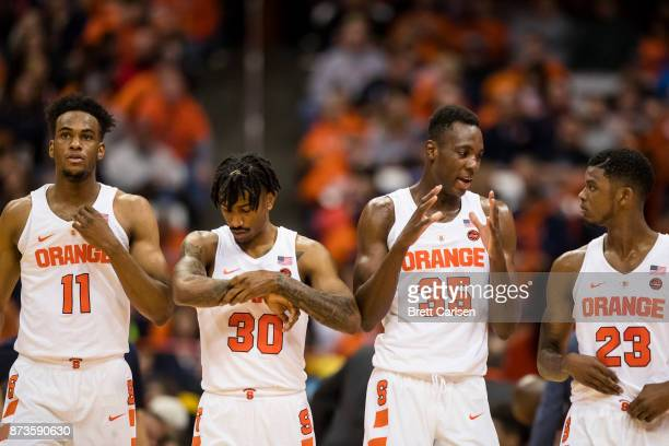 Oshae Brissett Geno Thorpe Bourama Sidibe and Frank Howard of the Syracuse Orange walk on the court during the game against the Cornell Big Red at...