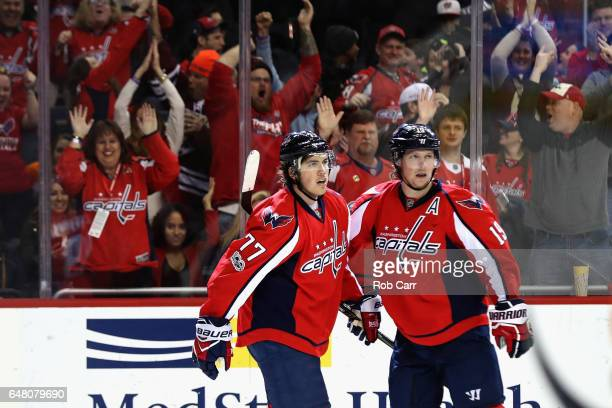 J Oshie and Nicklas Backstrom of the Washington Capitals celebrate after Backstrom scored the winning goal in overtime to defeat the Philadelphia...