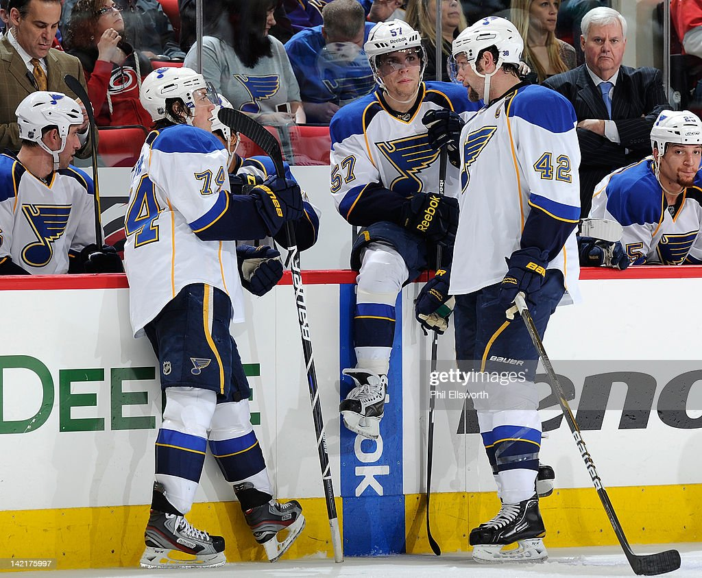 <a gi-track='captionPersonalityLinkClicked' href=/galleries/search?phrase=T.J.+Oshie&family=editorial&specificpeople=700383 ng-click='$event.stopPropagation()'>T.J. Oshie</a> #74, <a gi-track='captionPersonalityLinkClicked' href=/galleries/search?phrase=David+Perron&family=editorial&specificpeople=4282591 ng-click='$event.stopPropagation()'>David Perron</a> #57 and David Backes #42 of the St. Louis Blues have a discussion during an NHL game against the Carolina Hurricanes on March 15, 2012 at PNC Arena in Raleigh, North Carolina.